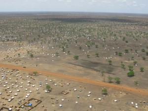 Aerial photograph of just one part of the Jamam camp in South Sudan, where some 36,000 people have fled to, following fighting near the border of Sudan's Blue Nile State, and South Sudan's Upper Nile State in the Greater Upper Nile region. Conditions are harsh and access to water is difficult, although aid agencies including UNHCR, Oxfam and Medecins Sans Frontieres are managing to make sure people receive an average of 6.5 litres of water a day – enough to meet basic needs.  April, 2013. Photo by Robert Stansfield/Department for International Development [CC-BY-SA-2.0 (http://creativecommons.org/licenses/by-sa/2.0)], via Wikimedia Commons.
