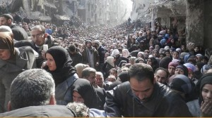 This photograph, taken on January 31 and released by UNRWA on February 26, shows the grim reality for those trapped inside the neighborhood of Damascus' Yarmouk Refugee Camp. Photo courtesy United Nation News Centre via Facebook. Read more: http://www.smh.com.au/world/portrait-of-despair-thousands-queue-for-un-food-parcels-in-yarmouk-damascus-20140227-hve0b.html#ixzz2uX0i9hoh     This photograph, taken on January 31 and released by UNRWA on February 26, shows the grim reality for those trapped inside Damascus' Yarmouk Refugee Camp. Photo courtesy United Nation News Centre via Facebook.