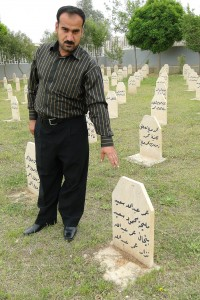 Bakhtiar Awmar points to grave where his father, mother and sister are buried - victims of the 1988 Chemical Attack - Halabja, Kurdistan - Iraq. Photo By Adam Jones, Ph.D. (Own work) [CC-BY-SA-3.0 (http://creativecommons.org/licenses/by-sa/3.0)], via Wikimedia Commons