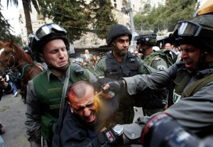 Israeli police pepper spray injured Palestinian protester. Photo courtesy Police Brutality Info (www.policebrutality.info)