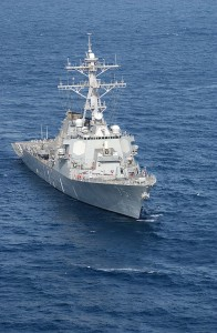 The guided missile destroyer USS Donald Cook (DDG 75) underway. Donald Cook was the first surface combatant to fire Tomahawk Land Attack Missiles (TLAM) in the liberation of Iraq. Photo By U.S. Navy photo by Chief Journalist Alan J. Baribeau. [Public domain], via Wikimedia Commons