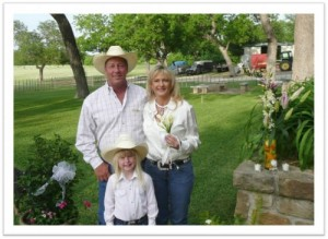 Bob and Lisa Parr with daughter Emma, on their wedding day outside the custom-built home on the 40 acre farm they purchased before any fracking in the area occurred. Photo courtesy TXSharon.