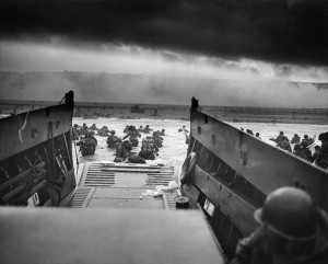 Landing at Omaha Beach, June 6,1944. By Chief Photographer's Mate (CPHoM) Robert F. Sargent. National Archives via Wikimedia Commons