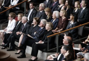 "Imagine ""upskirting"" photos being taken here.  Mrs. Laura Bush, first row-center, joins former President Jimmy Carter and his wife, Rosalynn Carter; former President Bill Clinton, and his wife, Hillary Clinton; Mrs. Nancy Reagan; Caroline Kennedy Schlossberg, her husband Edwin Schlossberg; Mrs. Barbara Bush; Susan Ford Bales, daughter of former President Gerald R. Ford; and Patricia ""Tricia"" Nixon Cox and her husband, Edward Cox, upper-right, at the funeral service for former first lady Lady Bird Johnson. Photo By Shealah Craighead, White House Photo Office [Public domain], via Wikimedia Commons"