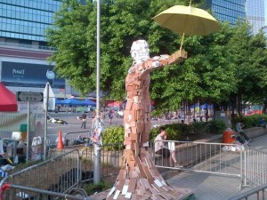 "The iconic image of ""Umbrella Man"" at the protest site in Hong Kong. Image via Twitter."