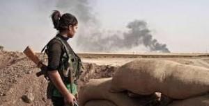 Kurdish YPJ fighter overlooks battlefield. Image via Twitter.