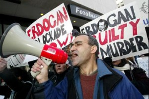 Kani Xulam during a protest in Washington, DC. Image via kurdistan.org