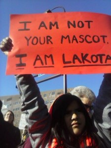 Justice Lone Hill at the #NotYourMascot march and rally. Photo by Dana Lone Hill via Facebook