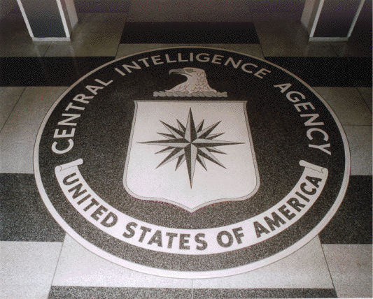 The seal of the Central Intelligence Agency inlaid in the floor of the main lobby of the Original Headquarters Building. Photo by user:Duffman (Own work) [Public domain], via Wikimedia Commons