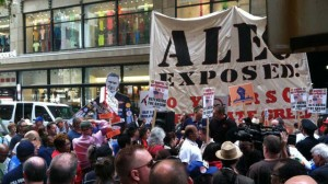 An anti-American Legislative Exchange Council (ALEC) protest in front of the Palmer House in Chicago. Police made violent arrests of protesters gathered to protest the lobbying group's conference. August, 2013. Image via Twitter.