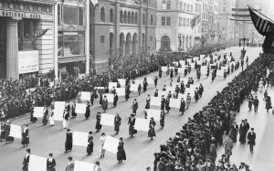 Suffragists march in October 1917, displaying placards containing the signatures of over one million New York women demanding to vote. Photo public domain via Wikimedia Commons