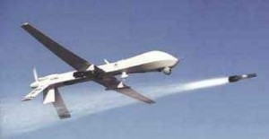 Armed Predator drone firing Hellfire missile. Photo public domain.