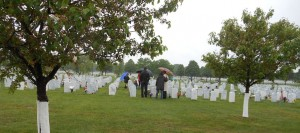 Families mark the graves of their loved ones at Fort Snelling National Cemetery. (Photo author's own work)