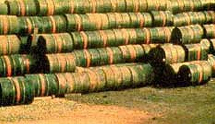 Leaking Agent Orange drums in Vietnam. Public domain via Wikimedia Commons