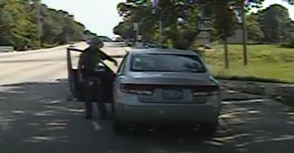 "In one shocking moment, the officer,  tells Bland that if she does not get out of her car he will ""light her up."" Subsequently, after she objects to having her head banged against the ground and telling him that she suffers from epilepsy, Encinia responds by saying, ""Good."" (Image: Screenshot/Youtube)"