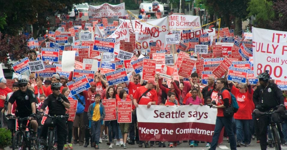 A crowd of red-clad teachers, parents and students marched through downtown Seattle on Tuesday. Organizers estimated at least 4,000 teachers were there. (Photo: Kyle Stokes KPLU)