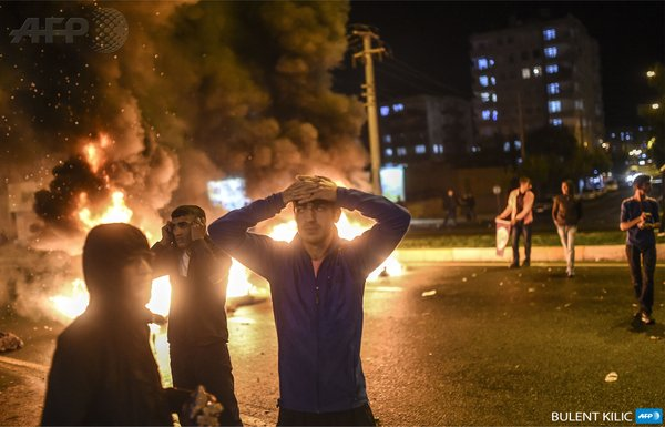 Youth react during clashes between Turkish police & Kurds in Diyarbakir after election results. Photo via Twitter