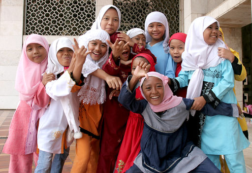 Muslim girls at Istiqlal Mosque in Jakarta posing in front of the camera. Photo by Henrik Hansson - Globaljuggler (Own work) [CC BY-SA 3.0] via Wikimedia Commons