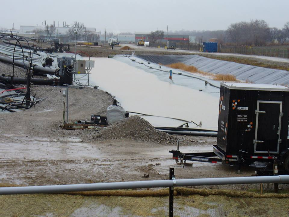 West Lake Landfill. The canal is filled to the brim and the canal to the right where the brown grasses are growing is being fed the overflow from the filled canal. Photo: Facebook