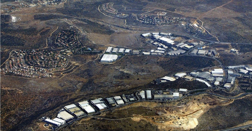 Barkan, located in the occupied West Bank, is an Israeli residential settlement and industrial zone that houses around 120 factories that export around 80 percent of their goods abroad. In the background is the Palestinian village of Qarawat Bani Hassan. (Photo: David Silverman/HRW)
