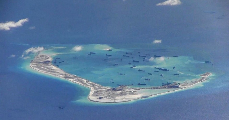 Chinese dredging vessels seen in the waters around Mischief Reef in the disputed Spratly Islands in the South China Sea in this video image taken by a P-8A Poseidon surveillance aircraft provided by the U.S. Navy, May 21, 2015.