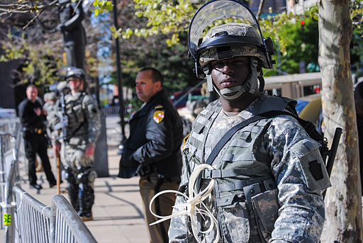 A Maryland Army National Guard Soldier keeps watch in front of City Hall in Baltimore, April 28, 2015. Photo: Wikimedia Commons